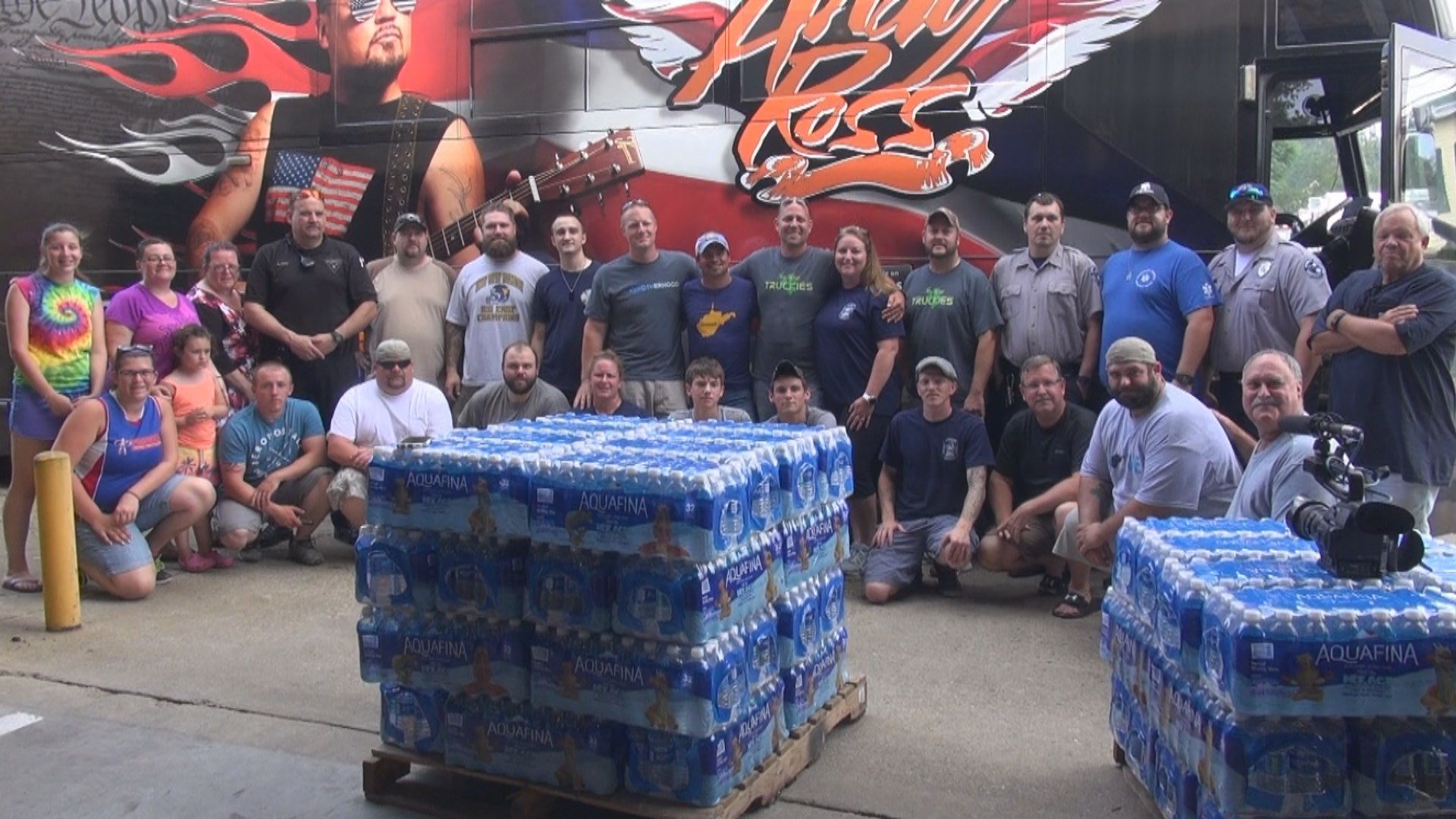 Volunteers with the Shinnston Fire Department pose with the Davisson Brothers, Owen Schmitt, and Andy Ross.