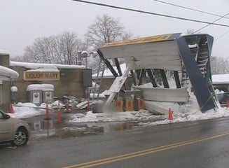 A Terra Alta gas station's awning collapses from heavy snow