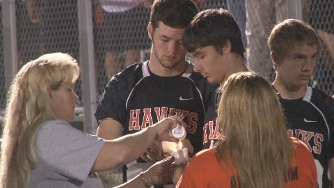 People gathered for a vigil at South Harrison High School on Sunday to offer support to injured football player Dylan Jeffries.
