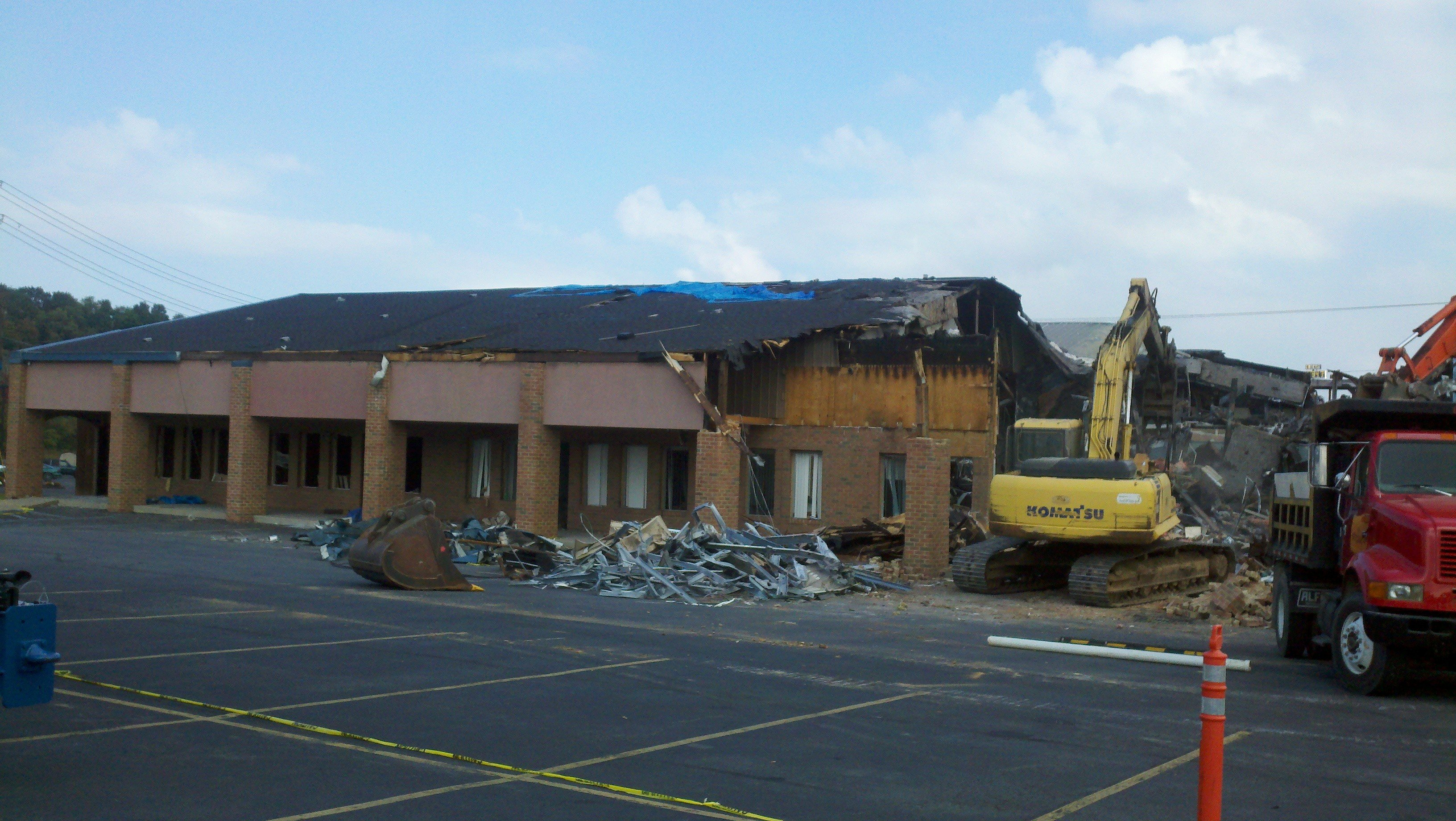 Workers began demolishing the Johnson Center in Bridgeport Wednesday after a fire destroyed the center in April.