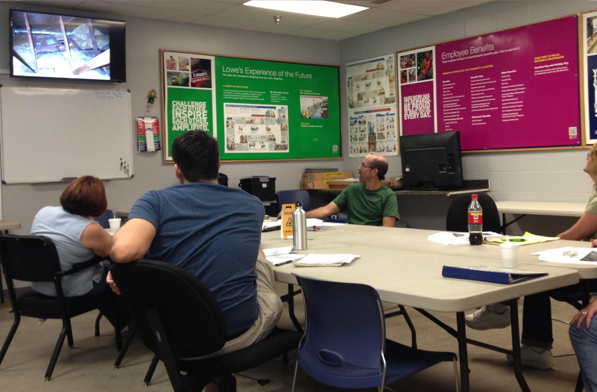 Chris Haddox explains energy efficient building to the class participants.