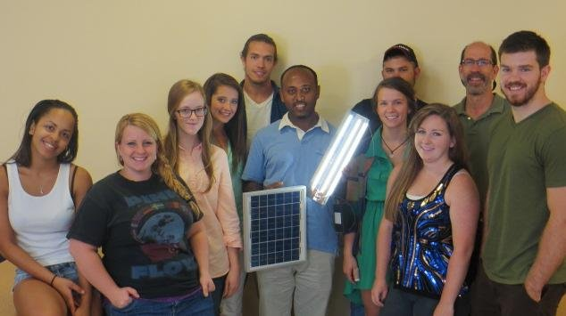 The DSGN 340 class with Belachew Amare, the WVU engineering student whose village they are assisting.