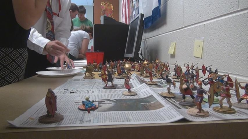 UHS students painting figurines for the re-enactment of The Battle of Thermopylae.