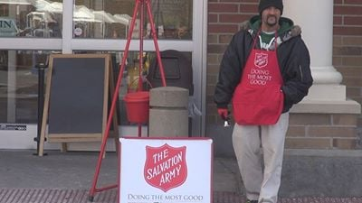 A Kettle Bell Ringer stand outside of the Suncrest Towne Center Kroger.