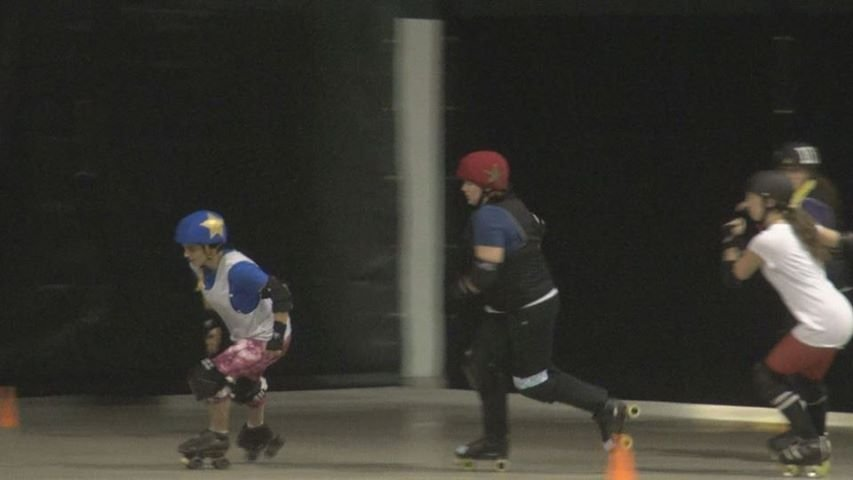 A member of the Roller Vixens laps the track during practice at Mylan Park.