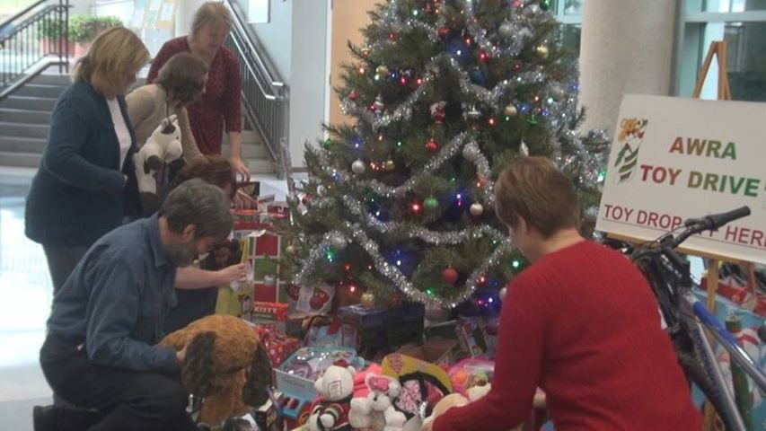 NIOSH employees arrange toys donated by co-workers for the Salvation Angel Tree Program and Christian Help.