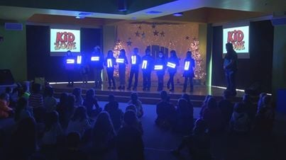 Children from the 'Kids Zone' show off the lights they made for New Vision.