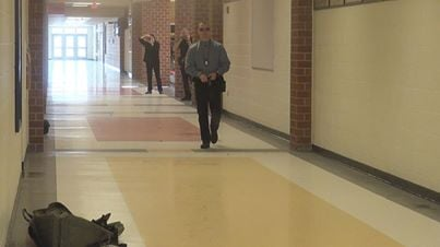 FBI Agent fires off blank rounds while walking towards a classroom filled with University High School faculty.