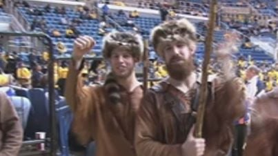 Michael Garcia, left, and Jonathon Kimble, right, competed against each other in the Mountaineer Mascot cheer off two years ago.