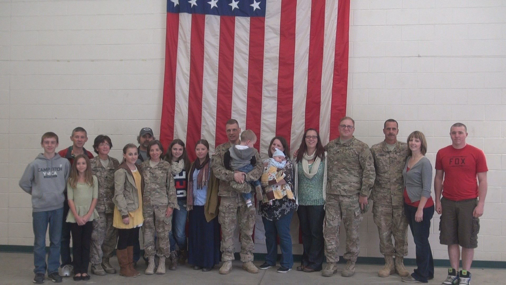 Members of the 328th QM DET and their families
