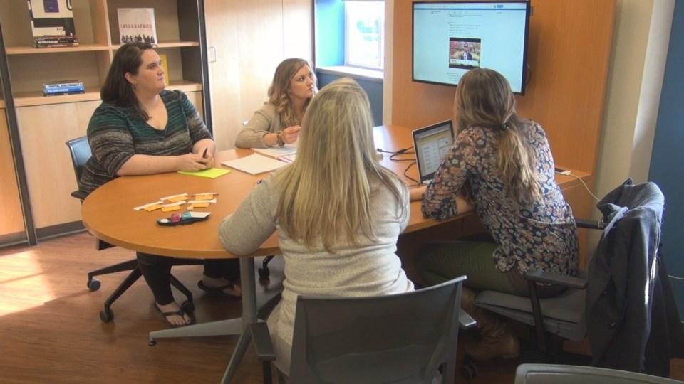 Enhance WVU members meet with their professor, Geah Pressgrove.