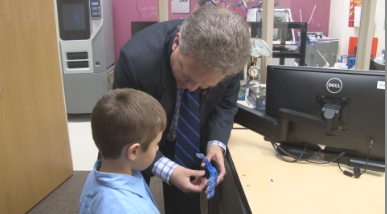 Professor Triplett showing Cooper the artificial hand.